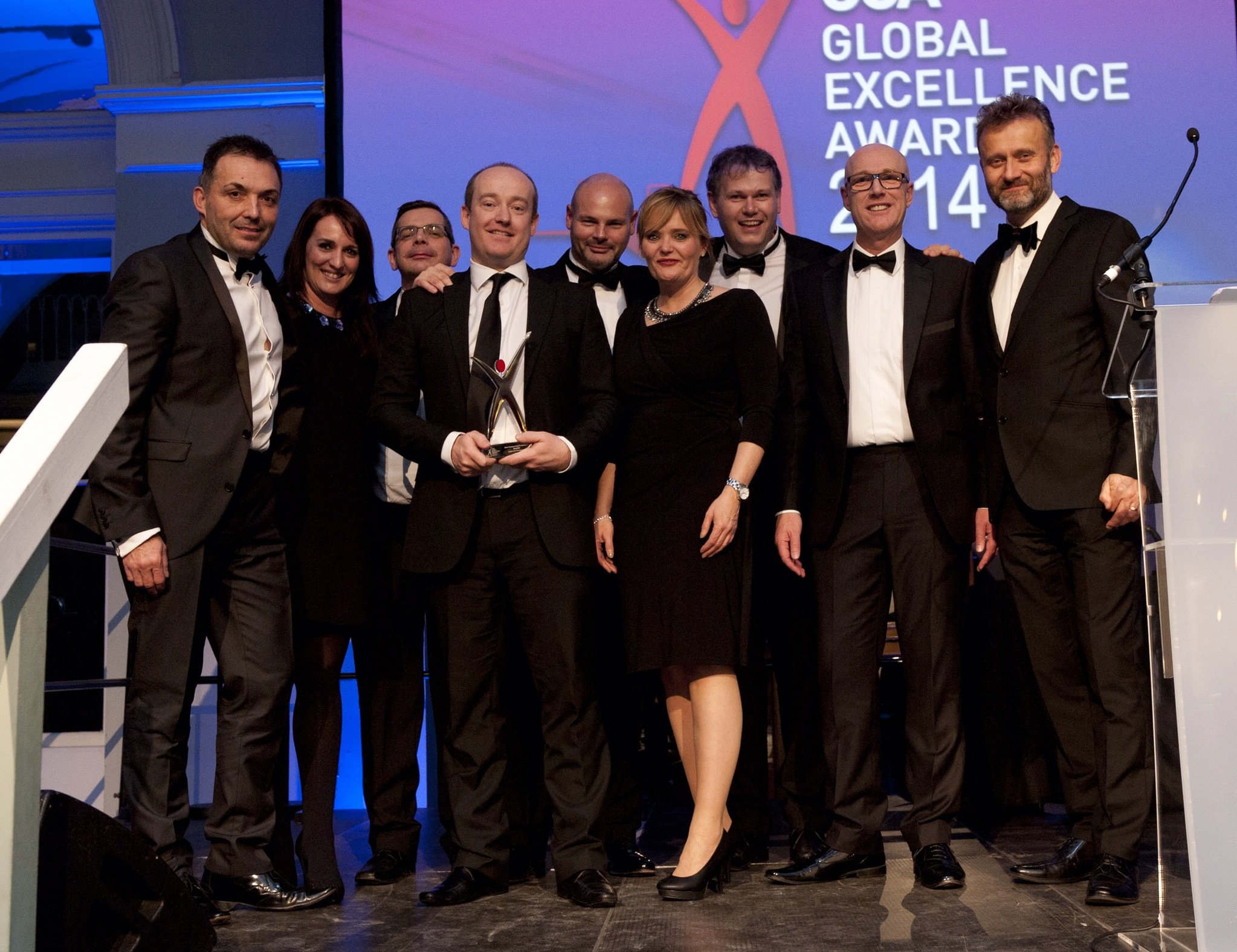 The Capita team collects their CCA Award